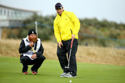Mark Boucher with his caddie on the 16th green during the second round of the 2014 Alfred Dunhill Links Championship at the Championship Links at Carnoustie on October 3, 2014 in Carnoustie, Scotland.