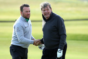 Greame McDowell shakes hands with Johan Rupert on the 18th green during day two of the 2018 Alfred Dunhill Links Championship at Carnoustie Golf Links on October 5, 2018 in, Carnoustie, Scotland.