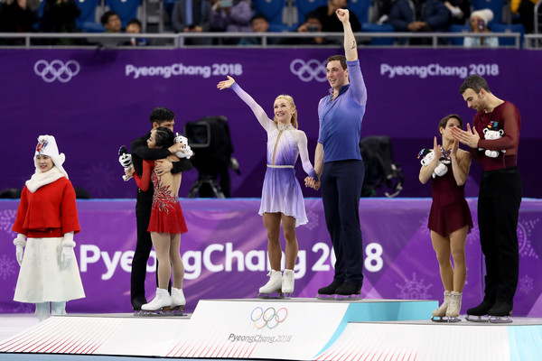 Figure Skating - Winter Olympics Day 6 [performance,recreation,competition,event,championship,games,sports,award,world,performing arts,winners,gold medal winners,cong han,wenjing sui,figure skating,medal,l-r,gangneung ice arena,germany,winter olympics]