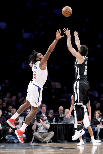 Los Angeles Clippers v Brooklyn Nets [basketball moves,basketball player,basketball,sports,ball game,basketball court,player,sport venue,team sport,tournament,allen crabbe,user,user,deandre jordan,shot,note,borough,brooklyn nets,los angeles clippers,game]