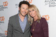 Mark Feuerstein (L) and NBCUniversal Cable Chairman Bonnie Hammer attend The Alliance For Children's Rights 26th Annual Dinner at The Beverly Hilton Hotel on March 28, 2018 in Beverly Hills, California.
