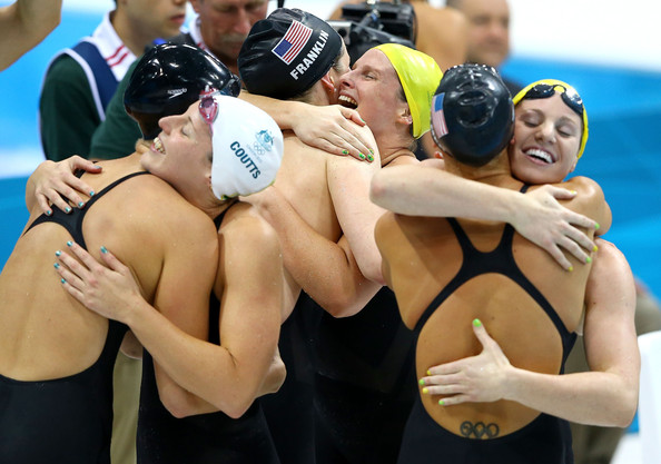 Olympics Day 8 - Swimming [swimmer,collegiate wrestling,swim cap,sports,individual sports,swimming,cap,competition event,scholastic wrestling,recreation,dana vollmer,each other,missy franklin,alicia coutts,allison schmitt,leisel jones,emily seebohm,united states,australia,olympics]