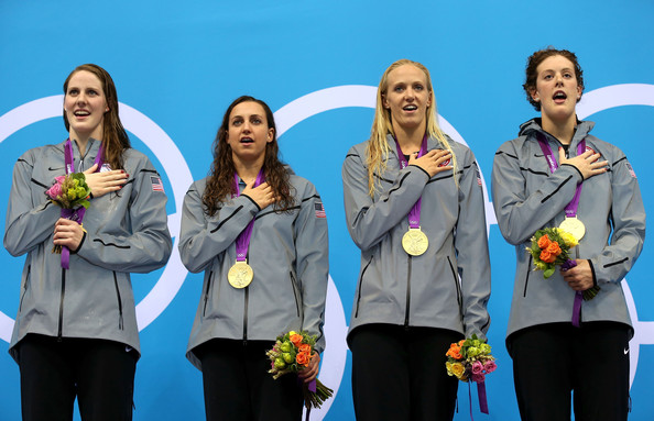 Olympics Day 8 - Swimming [medal,social group,award,silver medal,team,fun,event,gold medal,recreation,outerwear,rebecca soni,missy franklin,dana volmer,gold medallists,podium,united states,l-r,olympics,anthem,medal ceremony]