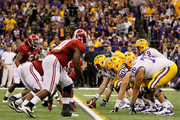 Jordan Jefferson #9 and the Louisiana State University Tigers line up against the Alabama Crimson Tide during the 2012 Allstate BCS National Championship Game at Mercedes-Benz Superdome on January 9, 2012 in New Orleans, Louisiana.