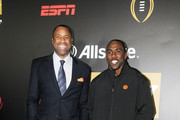 Former basketball player Greg Buckner (L) and football player C.J. Spiller pose on the blue carpet during the  Allstate Party At The Playoff on January 7, 2017 in Tampa, Florida.