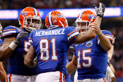 Aaron Hernandez #81 of the Florida Gators celebrates with his teammates Mike Pouncey #55 and Tim Tebow #15 after scoring a touchdown in the first quarter against the Cincinnati Bearcats during the Allstate Sugar Bowl at the Louisana Superdome on January 1, 2010 in New Orleans, Louisiana.