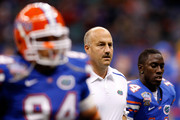 Offensive coordinator and interim head coach Steve Addazio (C) of the Florida Gators stands on the field before the Allstate Sugar Bowl against the Cincinnati Bearcats at the Louisana Superdome on January 1, 2010 in New Orleans, Louisiana.