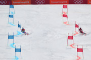 Tessa Worley (L) of France and Erin Mielzynski of Canada compete during the Alpine Team Event 1/8 Finals on day 15 of the PyeongChang 2018 Winter Olympic Games at Yongpyong Alpine Centre on February 24, 2018 in Pyeongchang-gun, South Korea.