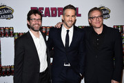 "(L-R) Rhett Reese, Ryan Reynolds, and Paul Wernick attend the ""Deadpool"" fan event at AMC Empire Theatre on February 8, 2016 in New York City."