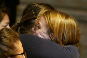 Amanda Knox's sister Deanna is hugged as she reacts after hearing the verdict that overturns Amanda's conviction and acquits her of murdering her British roommate Meredith Kercher, at the Perugia court on October 3, 2011 in Perugia, Italy. American student Amanda Knox and her Italian ex-boyfriend Raffaele Sollecito have won their appeal against their conviction in 2009 of killing their British roommate Meredith Kercher in Perugia, Italy in 2007. The pair had served nearly four years in jail after initially being sentenced to 26 and 25 years respectively.