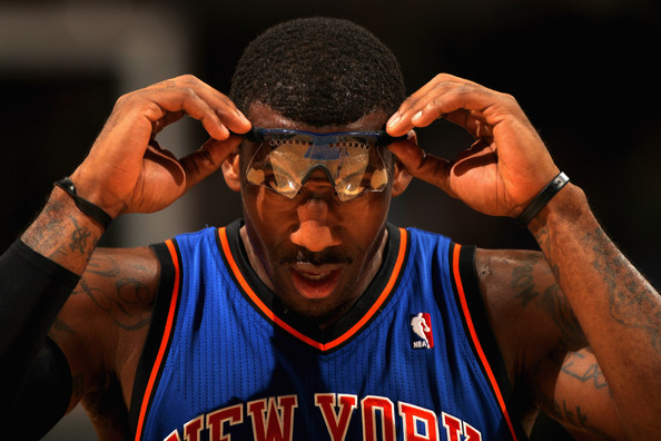 Amare Stoudemire Amar'e Stoudemire #1 of the New York Knicks adjusts his glasses as he faces the Denver Nuggets at the Pepsi Center on November 16, 2010 in Denver, Colorado. NOTE TO USER: User expressly acknowledges and agrees that, by downloading and/or using this Photograph, User is consenting to the terms and conditions of the Getty Images License Agreement.