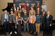 (Back row L-R) Caleb Miller, Simon Dumas, Jordan Harvey, Chad Michael Jervis, Austin Luther of musical group King Calaway, Coy Bowles of Zac Brown Band and Ryan Redington Director of Amazon Music, (middle row) Chris Deaton of King Calaway, Chris Fryar, Jimmy De Martini, Matt Mangano of Zac Brown Band and Kelly Rich of Amazon Music, (front row L-R) RJ Curtis Executive Director of CRS, Adam Hambrick, Tenille Townes, Zac Brown, Clay Cook, Daniel de los Reyes of Zac Brown Band and Kurt Johnson president of CRS take photos backstage during Amazon Music presents: Country Heat at CRS at Omni Hotel on February 13, 2019 in Nashville, Tennessee.