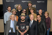 (Back row L-R) Ryan Redington Director of Amazon Music, Chris Fryar and Coy Bowles of Zac brown Band, (middle row L-R) Clay Cook, Jimmy De Martini, Matt Mangano of  Zac Brown Band and Kelly Rich of Amazon Music, (front row L-R) RJ Curtis Executive Director of CRS, Zac Brown of Zac Brown Band, Kurt Johnson and Daniel de los Reyes of Zac Brown Band take photos backstage during Amazon Music presents: Country Heat at CRS at Omni Hotel on February 13, 2019 in Nashville, Tennessee.