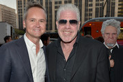 """Head of Amazon Studios Roy Price (L) and actor Ron Perlman attend the Amazon premiere screening for original drama series """"Hand Of God"""" at The Theatre at Ace Hotel on August 19, 2015 in Los Angeles, California."""