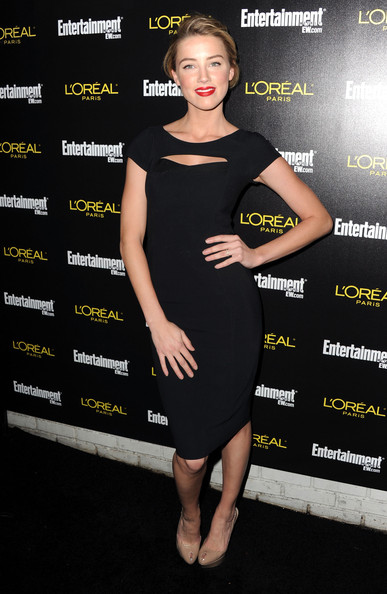 Amber Heard Actress Amber Heard arrives at Entertainment Weekly's celebration honoring the 17th Annual Screen Actors Guild Awards nominees hosted by Jess Cagle and presented by L'Oreal Paris at Chateau Marmont on January 29, 2011 in Los Angeles, California.