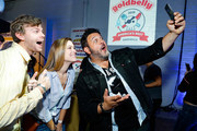 Adam Richman (R) takes a selfie with guests at America's Greatest Sandwich Showdown during New York City Wine & Food Festival at Highline Stages on October 13, 2019 in New York City.
