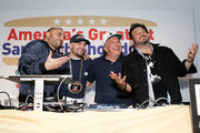 """(L-R) Founder & CEO of Goldbelly, Joe Ariel, NIck Gordon, Manny Loizos and Adam Richman celebrate the winning sandwich """"The Bomb"""" by Sal, Kris and Charlie's Deli at America's Greatest Sandwich Showdown during New York City Wine & Food Festival at Highline Stages on October 13, 2019 in New York City."""