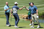 Former professional tennis athlete Mardy Fish is congratulated by Kyle Williams and John Smoltz after winning the American Century Championship at Edgewood Tahoe South course on July 12, 2020 in South Lake Tahoe, Nevada.