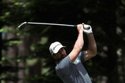 NFL athlete Aaron Rodgers of the Green Bay Packers plays a tee shot on the fourth hole during round one of the American Century Championship at Edgewood Tahoe South golf course on July 10, 2020 in Lake Tahoe, Nevada.