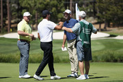Former NFL athlete Kyle Williams with the Buffalo Bills, former NFL athlete Tony Romo and former MLB pitcher John Smoltz congratulate each other after finishing round two of the American Century Championship at Edgewood Tahoe South golf course on July 11, 2020 in South Lake Tahoe, Nevada.