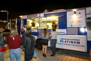 Guests enjoy American Express X La Pepa - Global Dining Collection Food Trucks on December 6, 2018 in Miami, Florida.