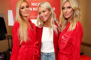 (L-R) Paris Hilton, Zanna Roberts Rassi, and Nicky Hilton Rothschild prepare backstage at The American Heart Association's Go Red For Women Red Dress Collection 2020 at Hammerstein Ballroom on February 05, 2020 in New York City.