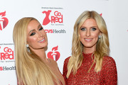 Paris Hilton and Nicky Hilton Rothschild attend The American Heart Association's Go Red For Women Red Dress Collection 2020 at Hammerstein Ballroom on February 05, 2020 in New York City.