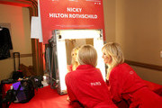 Paris Hilton and Nicky Hilton Rothschild prepare backstage at The American Heart Association's Go Red For Women Red Dress Collection 2020 at Hammerstein Ballroom on February 05, 2020 in New York City.