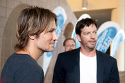 (L-R) Keith Urban and Harry Connick, Jr. are interviewed by press as they arrive at the Ernest N. Morial Convention Center on August 27, 2014 in New Orleans, Louisiana.