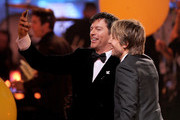 """American Idol Judges Harry Connick, Jr. (L) and Keith Urban takes a selfie onstage during Fox's """"American Idol"""" XIII Finale at Nokia Theatre L.A. Live on May 21, 2014 in Los Angeles, California."""
