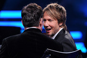 """American Idol Judges Harry Connick; Jr. (L) and  Keith Urban onstage during Fox's """"American Idol"""" XIII Finale at Nokia Theatre L.A. Live on May 21, 2014 in Los Angeles, California."""