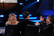 """American Idol Judges Jennifer Lopez, Harry Connick Jr., and Keith Urban speak onstage during Fox's """"American Idol"""" XIII Finale at Nokia Theatre L.A. Live on May 21, 2014 in Los Angeles, California."""