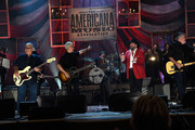 Conrad Lozano and Louie Perez of Los Lobos, Raul Malo of the Mavericks, and David Hidalgo of Los Lobos perform onstage at the 14th annual Americana Music Association Honors and Awards Show at the Ryman Auditorium on September 16, 2015 in Nashville, Tennessee.