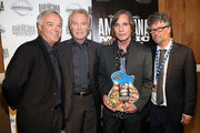 Ken Paulson, J.D. Souther, Jackson Browne, and Jed Hilly pose backstage at the 13th annual Americana Music Association Honors and Awards Show at the Ryman Auditorium on September 17, 2014 in Nashville, Tennessee.
