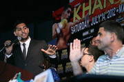 Professional boxer Amir Khan (L) exchanges words with trainer Angel Garcia (R), father of boxer Danny Garcia, during the Amir Khan v Danny Garcia - Press Conference at ESPN Zone At L.A. Live on June 4, 2012 in Los Angeles, California.