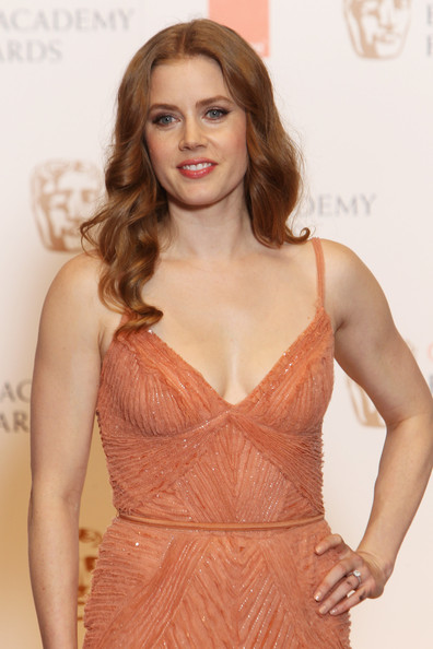 Amy Adams (UK TABLOID NEWSPAPERS OUT) Amy Adams poses in front of the winners boards at the Orange British Academy Film Awards 2011 held at The Royal Opera House on February 13, 2011 in London, England.