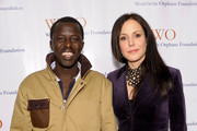 Okello Kelo Sam and actress Mary Louise Parker attend the Worldwide Orphans Foundation's Seventh Annual Benefit Gala hosted by Amy Poehler and Will Arnett held at Cipriani Wall Street on November 14, 2011 in New York City.