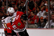 Marian Hossa #81 of the Chicago Blackhawks tries to control the puck in the second period as Simon Despres #24 of the Anaheim Ducks defends in Game Three of the Western Conference Finals during the 2015 NHL Stanley Cup Playoffs at the United Center on May 21, 2015 in Chicago, Illinois.