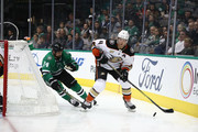 Cam Fowler #4 of the Anaheim Ducks and Jamie Benn #14 of the Dallas Stars in the third period at American Airlines Center on October 13, 2018 in Dallas, Texas.