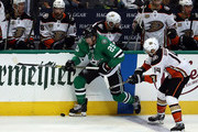 Brett Ritchie #25 of the Dallas Stars and Adam Henrique #14 of the Anaheim Ducks in the third period at American Airlines Center on October 13, 2018 in Dallas, Texas.