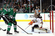 John Gibson #36 of the Anaheim Ducks makes a save in front of Valeri Nichushkin #43 of the Dallas Stars in the first period at American Airlines Center on October 13, 2018 in Dallas, Texas.