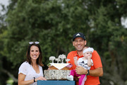 Sergio Garcia of Spain pose for a photo with his wife Angela Akins Garcia and their daughter after he wins the tournament as the third round resumes play on day five of Andalucia Valderrama Masters at Real Club Valderrama on October 22, 2018 in Cadiz, Spain. The event has been shorted to a 54 hole tournament due to bad weather.