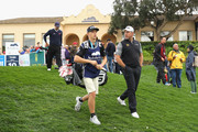 Lee Westwood of England walks off the 10th tee with his son and caddie Sam during the completion of the weather affected second round of the Andalucia Valderrama Masters at Real Club Valderrama on October 20, 2018 in Cadiz, Spain.