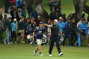 Lee Westwood of England walks down the ninth hole with his son and caddie Sam during the completion of the weather affected second round of the Andalucia Valderrama Masters at Real Club Valderrama on October 20, 2018 in Cadiz, Spain.