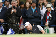 Lee Westwood of England plays a shot out of a bunker on the 18th hole during the completion of the weather affected second round of the Andalucia Valderrama Masters at Real Club Valderrama on October 20, 2018 in Cadiz, Spain.