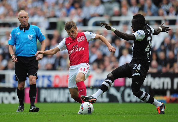Andrei Arshavin Andrei Arshavin of Arsenal is challenged by Cheik Tiote of <a href=
