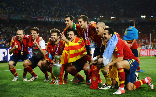 Spain v Italy - UEFA EURO 2012 Final [sports,team sport,ball game,team,sport venue,football player,player,soccer,soccer player,stadium,cesc fabregas,andres iniesta,pedro,victor valdes,uefa euro 2012 final,trophy,l-r,italy,spain,victory]
