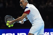 "Iran's Mansour Bahrami 'serves' during his exhibition doubles match with Britain's Tim Henman against Britain's Andy Murray and Britain's Jamie Murray at ""Andy Murray Live"" at the SSE Hydro in Glasgow, Scotland on November 7, 2017. .""Andy Murray Live"" is a charity fundraiser. Glasgow based charity, Sunny-sid3up, join Unicef as charity partner this year. / AFP PHOTO / Andy BUCHANAN"