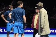 "Actors from the BBC Scotland sitcom ""Still Game"" speak with Britain's Jamie Murray (L) and his brother Andy during their doubles game against Britain's Tim Henman and Iran's Mansour Bahrami at ""Andy Murray Live"" at the SSE Hydro in Glasgow, Scotland on November 7, 2017. .""Andy Murray Live"" is a charity fundraiser. Glasgow based charity, Sunny-sid3up, join Unicef as charity partner this year. / AFP PHOTO / Andy BUCHANAN"