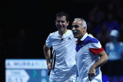 Mansour Bahrami and Tim Henman in action during their doubles match against Andy Murray and Jamie Murray during Andy Murray Live at The Hydro on November 7, 2017 in Glasgow, Scotland.